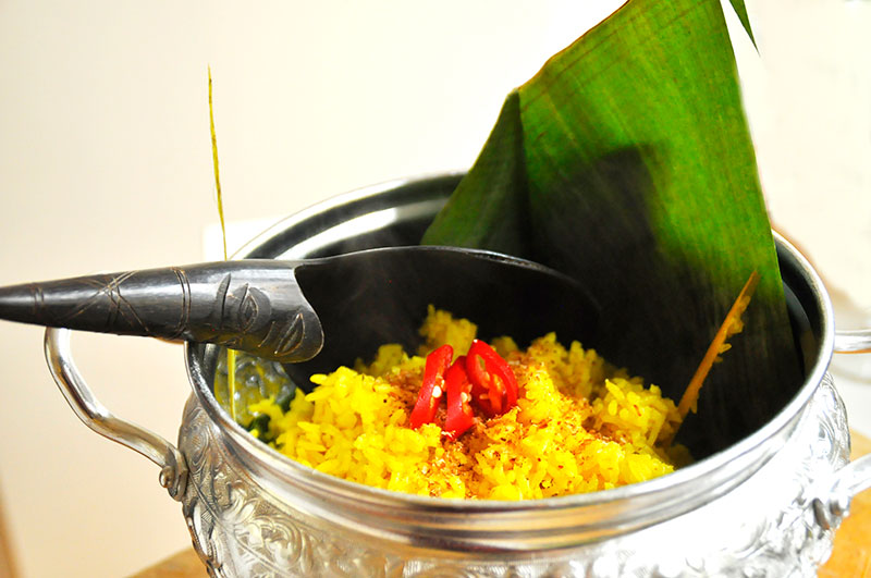 Nasi kuning indonesian yellow party rice easy recipe it is often eaten in indonesia during festivals anniversary wedding birthdays or a holy party the rice is flavored with santen coconut cream and forumfinder Choice Image
